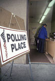 Election volunteers assisting voters in a polling place, CA Stock Photo