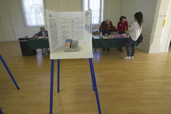 Election volunteers and voting booths in a polling place, CA Stock Photo
