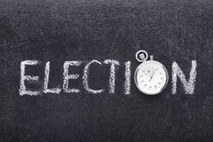 Election word watch. Election word handwritten on chalkboard with vintage precise stopwatch used instead of O Royalty Free Stock Photo