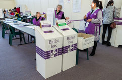 Election workers at an Australian polling booth. Stock Photos