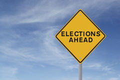 Elections Ahead. Road sign announcing elections ahead (against a blue sky background Stock Photo
