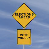 Elections Ahead. Road sign announcing elections ahead (against a blue sky background Royalty Free Stock Photo