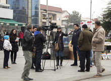 Electoral campaign before parliamentary elections in Macedonia on December 2016. Kavadarci, Macedonia - November 27, 2016: Reporters is interviewing Royalty Free Stock Photo