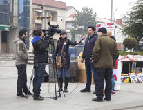 Electoral campaign before parliamentary elections in Macedonia on December 2016. Kavadarci, Macedonia - November 27, 2016: Reporters is interviewing Royalty Free Stock Image