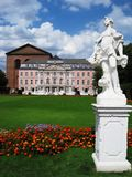 Electoral palace. Pink electoral palace behind white marble statue at hot,sunny day in Germany in Trier Stock Photo
