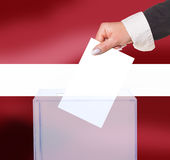 Electoral vote by ballot. Under the Latvia flag Royalty Free Stock Photo