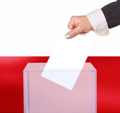 Electoral vote by ballot. Under the Poland flag Royalty Free Stock Photography