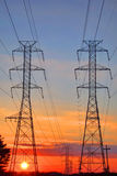 Electric AC Grid High Voltage Transmission Towers. Electric AC alternative current grid network power high voltage electricity transmission lines pylon towers Stock Images