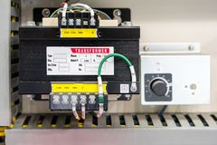 Electric AC transformer power supply unit in box or cabinet for industrial production line or machine.  royalty free stock image