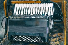 Electric accordion on a natural background Royalty Free Stock Photos