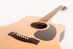 Electric acoustic yellow guitar close up isolated on white Stock Photo