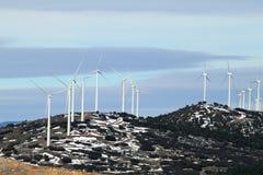 Electric aerogenerator windmills snow winter Royalty Free Stock Image