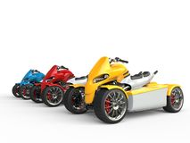 Electric all terrain vehicles - yellow one in focus Stock Image