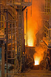 Electric arc furnace. Photograph shows the active stage melting of steel electrically on modern technology Stock Photos
