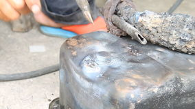 Electric Arc Welding The Crack of Oil Pan - Car Part Repairing stock footage