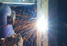 Electric arc welding. On square pipe royalty free stock photography