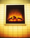 Electric artificial fireplace interior. Ad. Royalty Free Stock Image