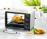 Electric automatic chicken toaster Stock Image