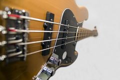 Electric bass. Closeup on a electric bass royalty free stock images