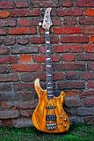 Electric Bass against a Wall Royalty Free Stock Photography