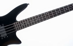Electric bass guitar. Detail of an electric bass guitar with four strings Royalty Free Stock Photo