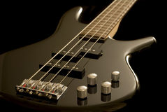 Electric bass guitar. Angled view of electric bass guitar with black background stock photo