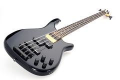 Electric bass guitar. Black electric bass guitar isolated on white background Stock Images