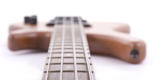 Electric bass guitar. High key shot of wooden bass guitar isolated on white Royalty Free Stock Photo