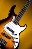 Electric Bass Guitar On Gold Royalty Free Stock Photo