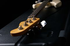 Electric Bass guitar headstock on black leather hard case Royalty Free Stock Images