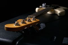 Electric Bass guitar headstock on black leather hard case Stock Photography