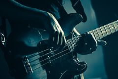 Electric bass guitar player hands, live music stock images