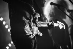 Electric bass guitar player, monochrome royalty free stock images