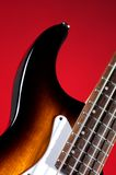 Electric Bass Guitar on Red Royalty Free Stock Photo