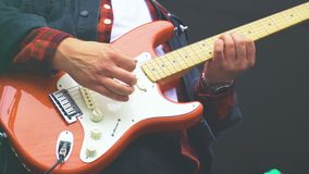 Electric and bass guitars in action. stock video
