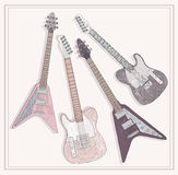 Electric and bass guitars set with floral pattern. Royalty Free Stock Photography