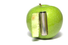 Electric battery in apple Stock Photo