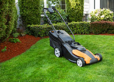 Electric Battery Lawn Mower on Front Yard Royalty Free Stock Photography