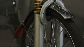 Electric bicycle details closeup, front wheel, shock absorbers on steerer tube stock video