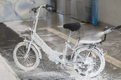 Electric bicycle with a jet of foam stock images