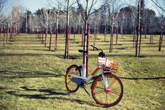 Electric bicycle parked in a park waiting for ret. Electric bicycle parked on meadow in  a park waiting for ret royalty free stock photos