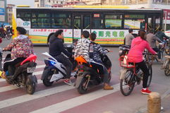 Electric bicycle at traffic intersection Stock Photo
