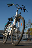 Electric bicycle. Electric white bicycle on asphalt royalty free stock image