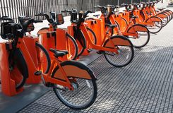 Electric bicycles parked at a bike sharing station.  stock photos