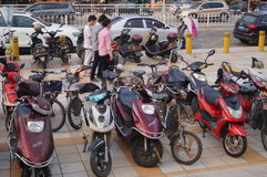 Electric bicycles parked in the school entrance Stock Photography