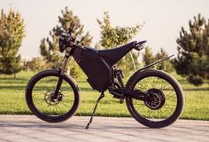 Electric bike battery motor wheel with pedal and rear shock absorber. Ebike bicycle environmentally friendly eco e-mountainbike transport. Healthy lifestyle royalty free stock photography