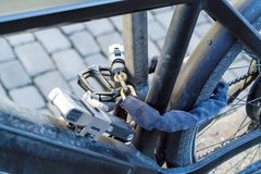 Electric bike, chained with several strong locks and chains. To protect against thieves stock photo