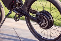 Electric bike motor wheel close up with pedal and rear shock absorber. Ebike bicycle environmentally friendly eco e-mountainbike transport. Healthy lifestyle royalty free stock photo