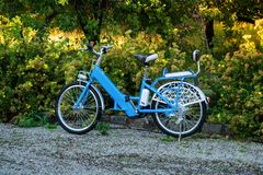 Electric bike in the park. Rental Electric bike in the summer park stock images