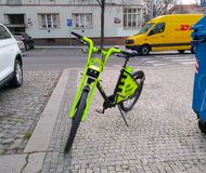 Electric bike parked on the sidewalk in Prague. 2019 stock photos